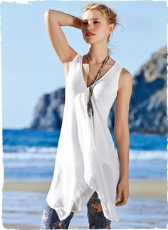 Quintessentially gypset, the floaty jersey tunic, constructed with two sheer chiffon panels in front that dip to a dramatically long, angular hem. White or Black cotton (51%) and modal (49%).