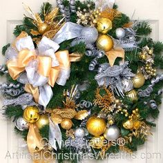 Silver and Gold Christmas Wreath - 2015 - Our Deluxe Silver and Gold Christmas Wreath is lavishly adorned with an abundance of sparkling holiday decorations. This wreath is sure to add a touch of elegance to your holiday decorating. #ChristmasWreath