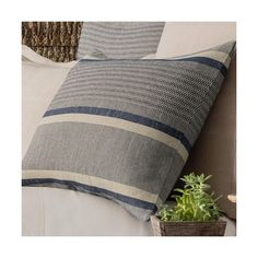 Add a pop of subtle African charm with this delicately striped linen/cotton sham. Its stripes of indigo and ivory layer perfectly with deep earthy hues, neutrals, and bold, colorful patterns.  • 50% linen/50% cotton.  • Knife edge.  • Envelope back closure with ties.  • Horizontal stripe.