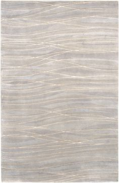 Hand-knotted with silk accents, this rug conveys movement and tranquility in…