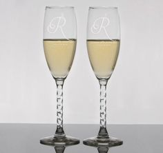 These Custom Initial Toasting Flutes are the perfect wedding flutes to make your first toast with.  Flutes are engraved with your initial, names and wedding date.  A beautiful keepsake of your special day that will be treasured forever.