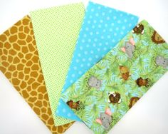 4 Pack of Flannel Fabric Fat Quarters in a Bundle of Baby Jungle Animals, Aqua Dots, Green Plaid and Giraffe Matching Prints