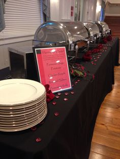 black and red decorated buffet tonight at herrington on the bay. Their dinner will be Herrington's salad, Parmesan sage potatoes, chicken royale, roasted salmon, and homemade rolls. YUM!!
