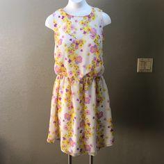 "ASOS floral dress NWOT cream dress with floral design. Length 37"", elastic waist band, cris cross back, sweetheart neckline. ASOS Dresses Mini"