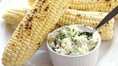 Make the most of this summer's corn bounty by pairing grilled cobs with a slather of cheesy, herb-enlivened butter.