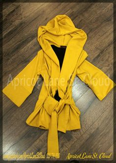 We are getting ready for the fall here at Apricot Lane St. Cloud and what better way to do that, then with an adorable jacket. We just received this amazing mustard yellow jacket ($48) in. Everything from the 3/4 sleeve, the hood, and even the tie in the front make this an amazing jacket to add to your closet. We will be receiving it in taupe and plum as well. To add this must have coat to your closet, give us girls of Apricot Lane St. Cloud a call at 320-774-1533 or visit and follow us on…