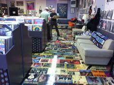 Floor covered in album covers and veneer. DROOOOOOOOL for a music room!