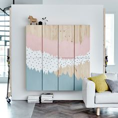 Mural Storage. IVAR cabinets with a painted mural on them in blue, white, and pink. IKEA