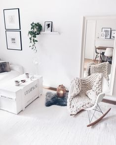 white living room with chunky knit plaid and eames chairs couch table box