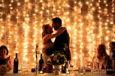 couple infront of fairy lights
