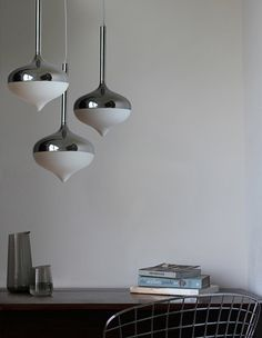 The Spun lamp was inspired by the classic wooden top toy, creating a decorative lighting piece available as a floor, table and pendant lamp.   http://www.eviegroup.com/spun.htm