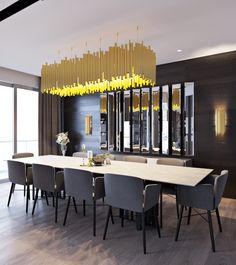 Dark Themed Interiors: Using Grey Effectively For Interior Design - designers Elvin Aliyev and Leyla Ibrahimova, there is significantly more color than we've seen in the previous spaces. While grey is certainly the background, stunning gold chandeliers and colorful throw pillows brighten things up. The natural wood floor even has a grey tint to it, but the addition of the wood grain (or is it grey-n?) makes it feel much warmer.