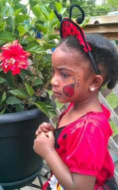 Ladybug face painting...this back yard looks familiar! :) Remember that party for the kids