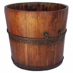 """Handcrafted elm wood bucket with iron banding and handles.     Product: BucketConstruction Material: Elm wood and ironColor: NaturalFeatures: Two handlesHandcraftedDimensions: 9.5"""" H x 11.5"""" DiameterCleaning and Care: Wipe down with clean cloth and lemon oil"""