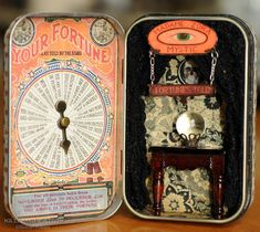 Wicked Circus altered Altoid tin by Killam Creative at Craftster.  The table is dollhouse furniture, crystal ball is a marble.  I love the spinner.
