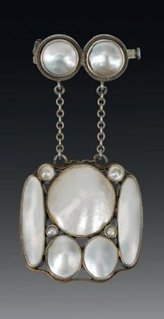 """Josef Hoffmann - A Jugendstil silver, gilt and mother of pearl pendant, Vienna. Marked on the edge """"WW"""", with Vienese assay marks. Formerly the property of Emilie Flöge, an Austrian fashion designer, business woman and the life companion of Gustav Klimt."""