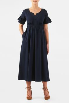 Our cotton knit dress in a blousony silhouette is styled with a trapunto stitch banded split neck and short sleeves with ruffled cuffs.