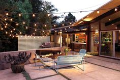 Magnificent Kichler Outdoor Lighting trend Santa Barbara Midcentury Patio Decorating ideas with backyard cactus container plants exterior lighting metal patio furniture midcentury modern modern fire pit Modern Backyard, Backyard Patio, Backyard Landscaping, Diy Patio, Pool Garden, Patio Table, Patio String Lights, Hanging Lights, String Lighting