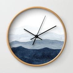 Buy Indigo Abstract Watercolor Mountains Wall Clock by ccartstudio. Worldwide shipping available at Society6.com. Just one of millions of high quality products available.