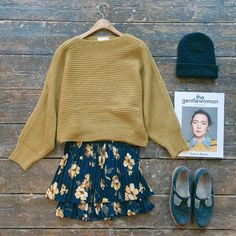 """""""Matching our mustards. Unbalanced Lip-neck knit jumper, pleated floral mini skirt, Brixton beanie and the gentle woman magazine all online now """""""