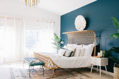 a suburban track home master bedroom got the makeover of a lifetime. love the paint choice and the bed!
