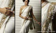 Varija Bajaj. cream and gold.  i will have to do some research on this designer.