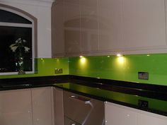 Would look better with white cabinetry and light bench. 'Green Kitchen Splashback' - © TNC Granite