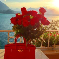 Red roses and red Hermes bag for the lady