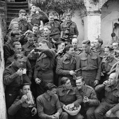 Men of the 2/6th Queen's Regiment celebrate Christmas in Italy, 25 December 1943.
