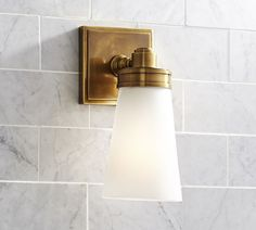 Details like a flared shade and beveled back plate lend distinctive style to this sconce. Cast of zinc alloy with a glass shade. Finished in Brass, Chrome, Polished Nickel, Satin Nickel or Matte Black. Features blown glass. Damp UL-listed for use indoors or in a protected outdoor area. Hardwired; professional installation recommended. Light bulb(s) are not included. Available individually or as a set of 2. Imported.