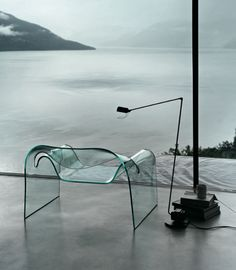 Fiam Ghost Chair, a monolithic chair in 12mm thick curved glass.