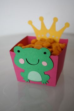 Snack box for KG's party      Prince or Princess Frog Crown Popcorn Goldfish Candy Snack Treat Cup. $12.00, via Etsy.