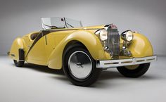 Bright yellow 1935 Bugatti Type 57.  If you are lucky enough to own one of these, make sure it's insured and visit:  www.americancollectors.com.