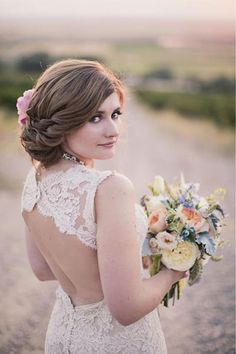 This gorgeous side-swept hairstyle is perfect for a wedding (Wedding Hairstyles that cover your ears)