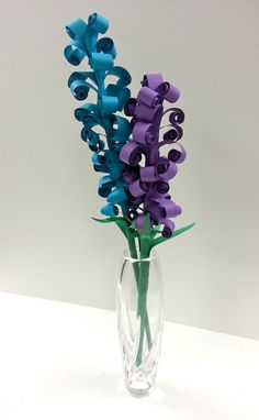 http://www.teacherspayteachers.com/Product/Mothers-Day-Flower-Art-Curled-Paper-Flower-Sculpture-Tutorial-video-included-1229613; Could be done with a 2nd grade class