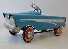 Vintage pedal car. Car makers used to make these to look just like the real cars, to give to the people (for their children) when they purchased the car.
