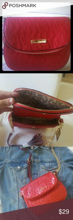 RED CROSS BODY BAG BEAUTIFUL RES CROSSBODY BAG,A LOT OF ROOM TO FIT WALLETS PHONES AND MORE.DESIGNER INSPIRED EXCELLENT QUALITY AND STYLE PERFECT FOR HOLIDAYS BE CHIC! AVAILABLE IN RED MATTE AND RED CHAROL. LET ME KNOW YOUR CHOICE WHEN YOU BUY IT YOU WILL LOVE IT! Price firm. Noble Exchange NX Bags Crossbody Bags