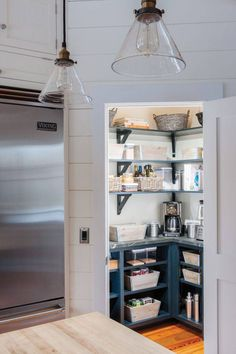 In this photo provided by Crown Point Cabinetry, ample counter space and open shelving with decorative brackets create a functional corner pantry with a place for everything. (Crown Point Cabinetry via AP) cabinets decor ideas open shelves Kitchen Pantry Design, Kitchen Corner, New Kitchen, Kitchen Storage, Kitchen Decor, Kitchen Small, Kitchen Shelves, Stairs Kitchen, Kitchen Pantries