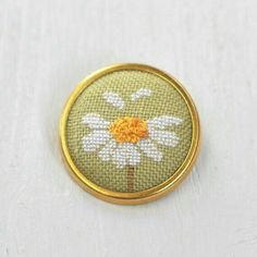 Daisy Brooch Pin // Hand Embroidered Floral by LivingOnTheRainbow 123 Stitch, Tiny Cross Stitch, Cross Stitch Boards, Cross Stitch Flowers, Cross Stitch Designs, Cross Stitch Patterns, Beaded Embroidery, Cross Stitch Embroidery, Hand Embroidery