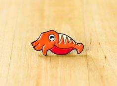 One cuttlefish enamel pin, perfect for cephalopod enthusiasts.  - THE NITTY GRITTY - ✎ One 1-inch (25mm) soft enamel pin, made from my original