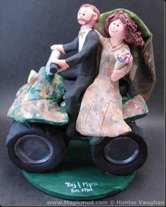 Camouflage Bride Wedding Cake Topper...A wedding cake topper for true outdoor enthusiast's is what comes to mind when first glimpsing this …  …you can imagine being out in the woods when you hear their trusty atv advancing like a modern day faithful steed…the bearded groom and his beautiful bride decked out in the finest of camouflage gowns… with matching veil.. $260 #atv#off_road#wedding #cake #toppers  #custom #Groom #bride #anniversary #birthday#wedding_cake_toppers#cake_toppers#figurine#...