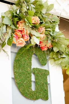Moss Initial + Garland -- See more of the wedding on #smp here: http://www.StyleMePretty.com/2014/04/11/bright-spring-dana-point-harbor-wedding/ Photography: AshleeRaubach.com -- SweetCarolinesFloralDesign.com