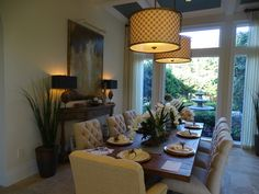 Dining room ~ Quail West model home ~ Interior design by Tricia Lynch, Robb & Stucky Naples