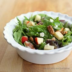I make this salad with pecans or almonds, craisins and feta cheese. I used to buy Brianna's Blush Wine Vinagrette, but the recipe on here is so easy and way cheaper. And delicious, of course.