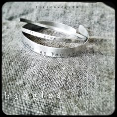 s i e b e n w e l l e n    bangles.  sterling-silver, poetry stamped,