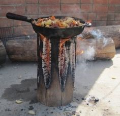 They call it a 'Swedish Torch' and we call this Log Stove pure genius. You'll want to try out the DIY Tin Can Rocket Stove too!