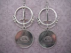 I am SO in love with all this witchy jewelry coming out now! - LR | All Seeing Eye Cross Chain Illuminati Earrings on Etsy, $22.00