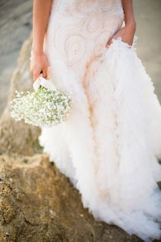 This Reem Acra gown is to.die.for: http://www.stylemepretty.com/little-black-book-blog/2015/06/11/malibu-beach-post-wedding-shoot/ | Photography: Betsi Ewing - http://betsiewing.com/