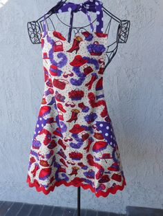 Red Hats apron reverses to purple with white dots has red ric rac on the hemline