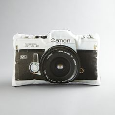 """""""You're either a Canon buff or a Nikon fanatic. If you belong to team Canon, this throw pillow deserves a place in your pillow mashup. Featuring the image of a vintage Canon camera, the pillow takes couch art to a whole new level."""" I'm a canon fan, haha Photo Pillows, Vintage Cameras, Pillow Talk, Pillow Fight, Dot And Bo, My Room, Brooklyn, Throw Pillows, In This Moment"""